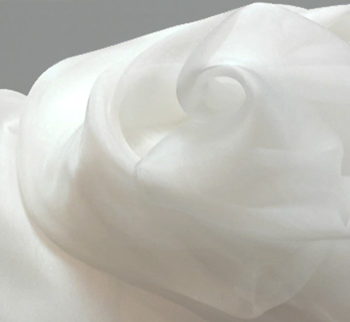 Similar as the Chiffon 3.5 but denser and shinier. Its weight is about 20 grams per square meter. Natural white scarves are hand-bordered with silk thread.
